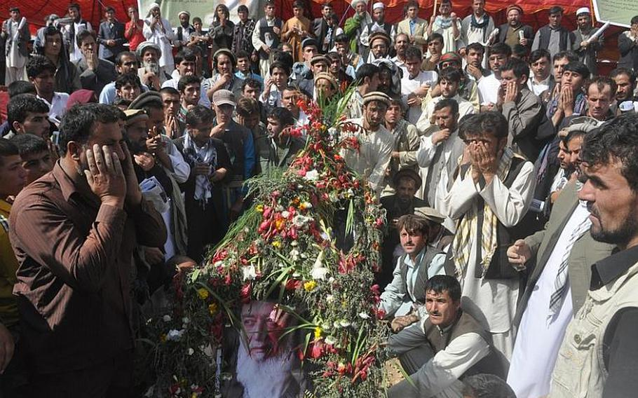 Mourners pray inside the burial pit where former Afghanistan President Burhanuddin Rabbani was laid to rest in Kabul on Friday. Rabbani headed the country's High Peace Council, a body formed last year by President Hamid Karzai to negotiate an end to the Taliban-led insurgency.