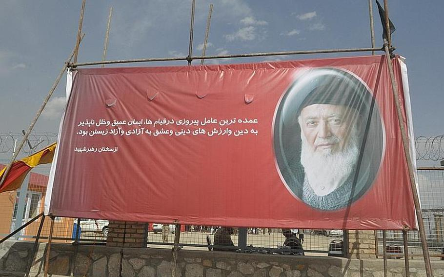 A banner near the gravesite of former Afghanistan President Burhanuddin Rabbani, who was laid to rest in Kabul on Sept. 23, 2011. A suicide bomber who claimed to represent the Taliban assassinated Rabbani in his home earlier that week.