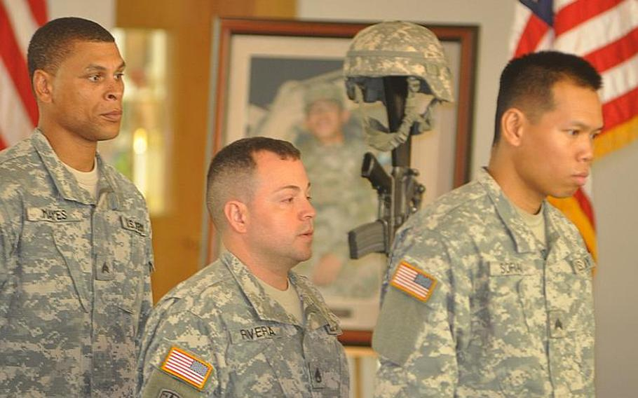 Sgt. Winarto Sofian, right, Staff Sgt. Victor Rivera, center, and Sgt. Rumonde Mayes march in line after paying their respects to Pfc. Alberto L. Obod Jr. Tuesday at the Bamberg community chapel.