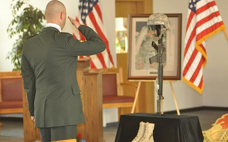 A soldier renders a salute to Pfc. Alberto L. Obod Jr. on Tuesday following a memorial service at Bamberg community chapel on Warner Barracks in Bamberg, Germany. Obod died Aug. 25 from injuries sustained in a vehicle roll-over in Afghanistan, the Defense Department said in a press release.