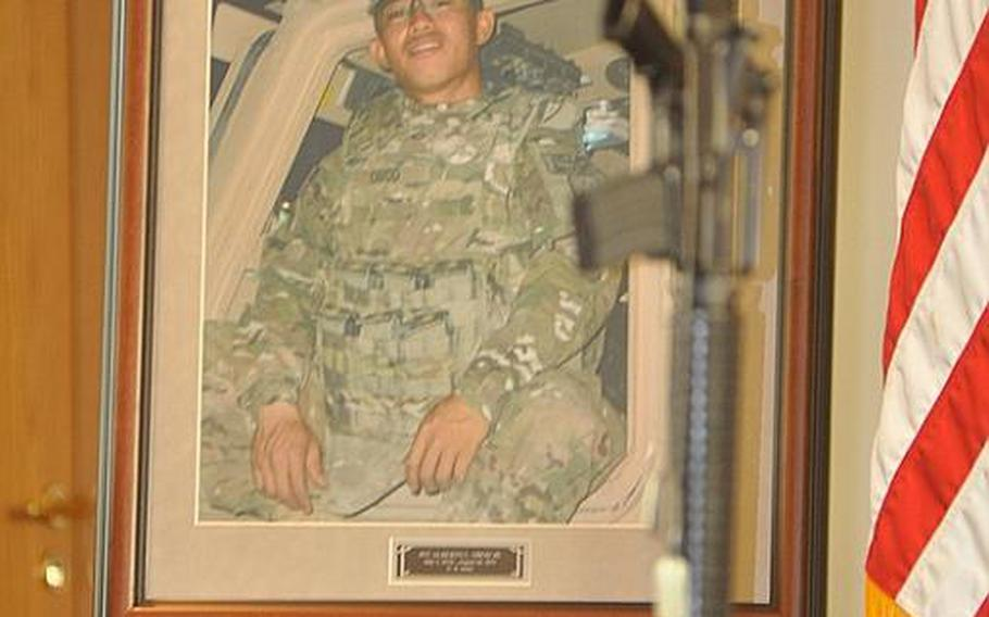 The contagious smile of Pfc. Alberto L. Obod Jr. is seen in a photograph of him Tuesday at the Bamberg community chapel in Germany. Obod died Aug. 25 from injuries sustained in a vehicle roll-over in Afghanistan, the Defense Department said in a press release.