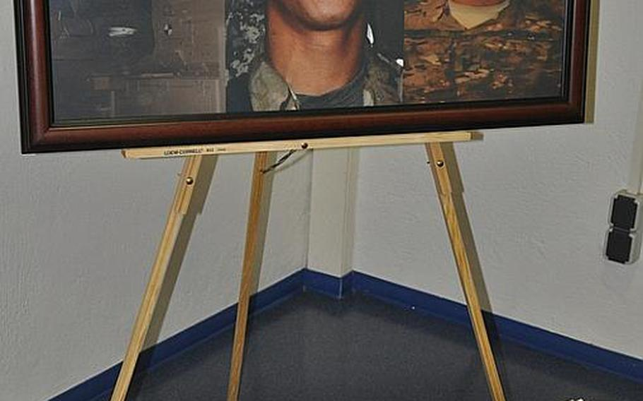 A guest book is placed in front of a photo collage of Pfc. Alberto L. Obod Jr. at the entrance of the Bamberg community chapel on Warner Barracks in Bamberg, Germany Tuesday. A memorial service was held for Obod, who died Aug. 25, from injuries sustained in a vehicle roll-over in Afghanistan, the Defense Department said in a press release.