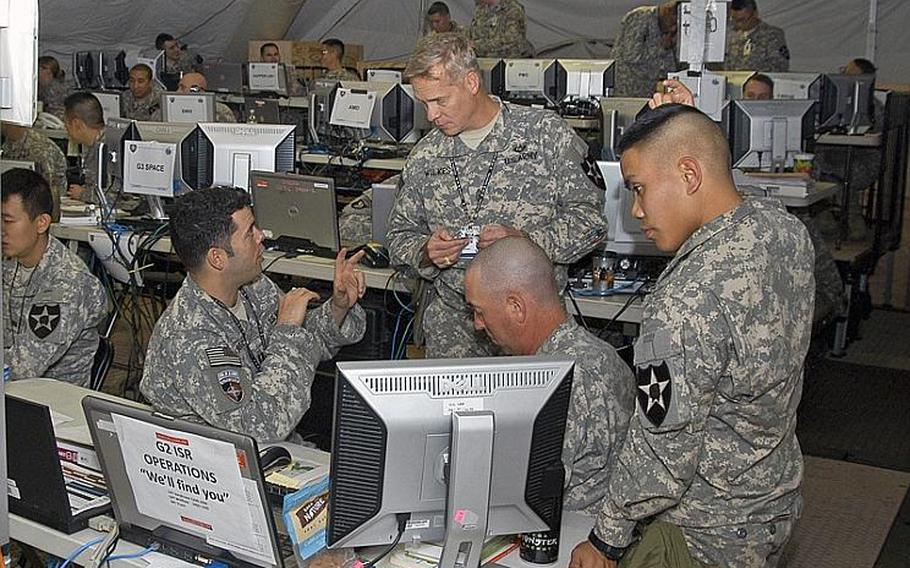 U.S. Soldiers confer in November 2011 in one of the operations centers utilized during Warpath III - an exercise during which about 1,000 American and South Korean soldiers practiced how they would respond to a chemical or biological attack by North Korea.