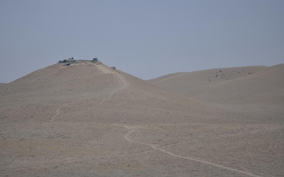 """Afghan police outposts like this one are scattered throughout western Faryab, where American forces have struggled for months to win over a mostly Pashtun populace that is still wary of U.S. forces and the Afghan government. """"I never thought Gormach would change,"""" said Lt. Col. John O'Grady, commander of the 1-84 Field Artillery Battalion. """"But it has.""""  Neil Shea/Stars and Stripes"""