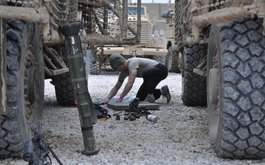 A soldier from Charlie Battery, 1-84 Field Artillery Battalion, cleans equipment during a maintenance day at COP Gormach in western Faryab province. Long before the Americans arrived, Soviet troops occupied the spot. Before the Soviets, British soldiers camped there, U.S. commanders said.