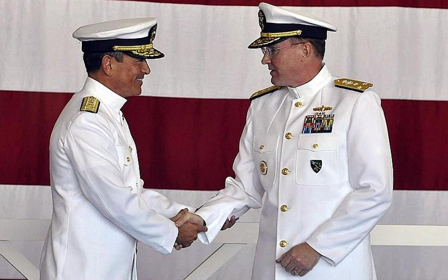 Navy 6th Fleet commander Vice Adm. Frank C. Pandolfe, right, shakes hands with outgoing commander Vice Adm. Harry B. Harris, Jr. during a change of command ceremony in Naples, Italy in October.