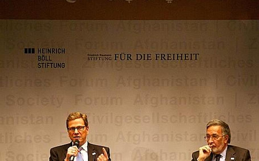 German Foreign Minister Guido Westerwelle, left, addresses questions at a forum Saturday on Afghan civil society in Bonn, Germany. Afghan Foreign Minister Zalmai Rasoul, right, also addressed attendees,  including nearly three dozen Afghans representing various Afghan civil institutions.