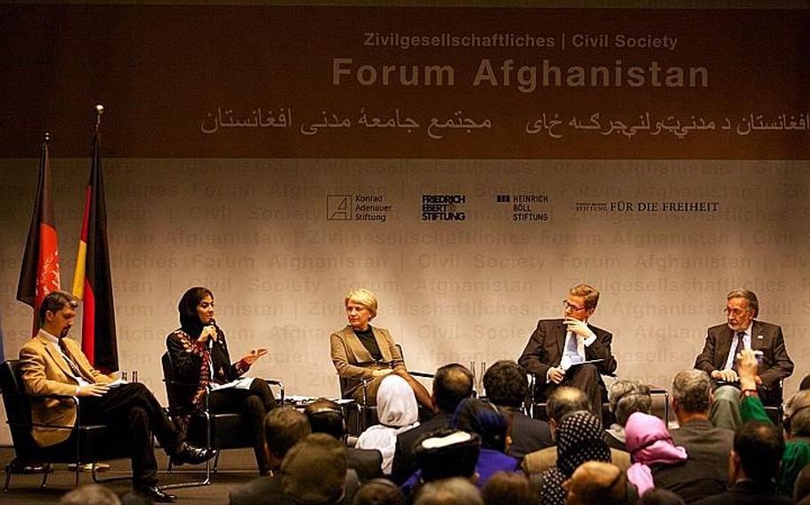 Selay Ghaffar, director of Humanitarian Assistance for the Women and Children of Afghanistan, speaks Saturday during a conference on Afghan civil society in Bonn, Germany, which was attended by German Foreign Minister Guido Westerwelle, second from right, and Afghan Foreign Minister Zalmai Rasoul, right.