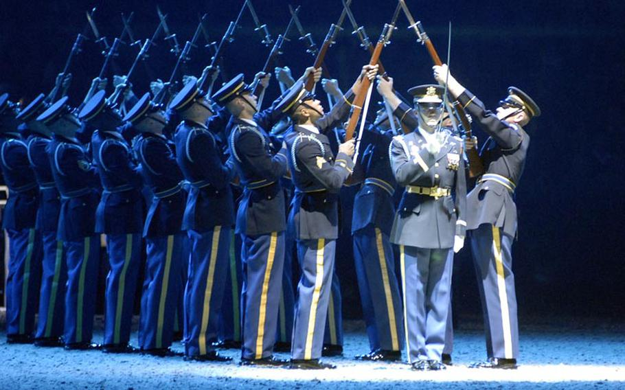Capt. Christopher Miorin, commander of the U.S. Army Drill Team, 3rd U.S. Infantry Regiment (The Old Guard), salutes with his sword Dec. 2, during the 2011 British Military Tournament in London. Miorin, from Harrisburg, Pa., often risks being hit by bayonet-tipped rifles.