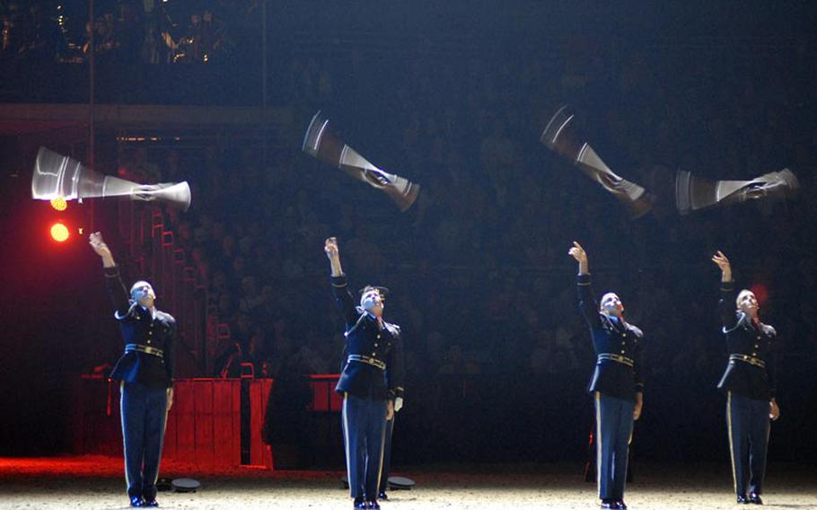 Members of the U.S. Army Drill Team, part of The Old Guard, toss their bayonet-tipped 1903 Springfield rifles in the air during the British Military Tournament in London on Dec. 2, 2011. The rifles weigh about 10 pounds and are often thrown blindly to other members of the team.