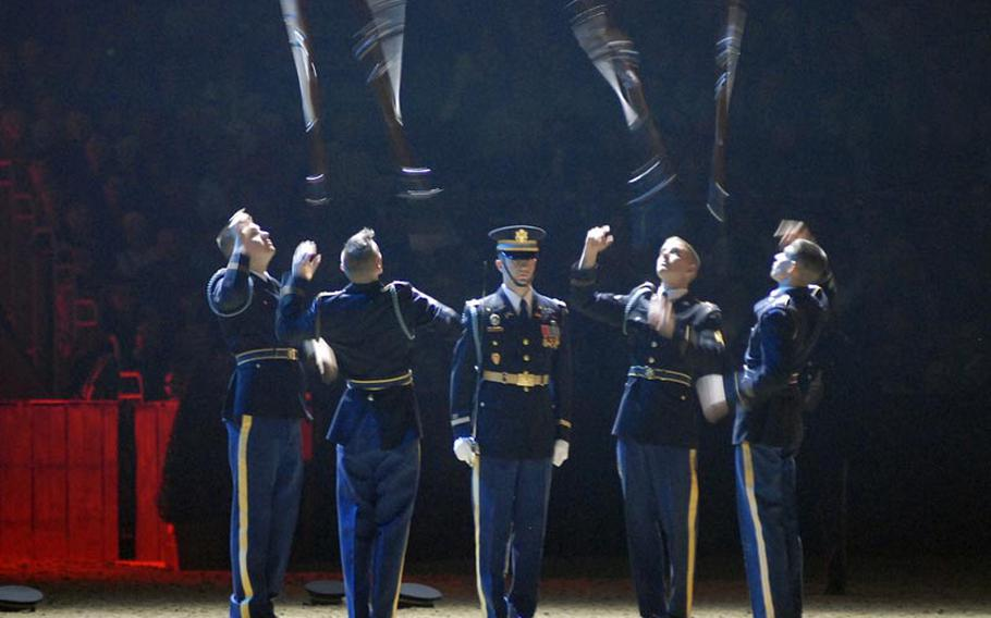Members of the U.S. Army Drill Team send their bayonet-tipped 1903 Springfield rifles spinning in the air while their commander, Capt. Christopher Miorin, stands at attention in the center of the circle at the 2011 British Military Tournament in London on Dec. 2.