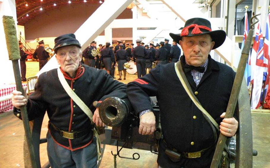 World War II veteran Joseph Francis, 91, and his son, Michael, stand in front of their Napoleon six-pounder cannon as part of the Southern Skirmish Association Civil War re-enactment group, which performed at the 2011 British Military Tournament in London.