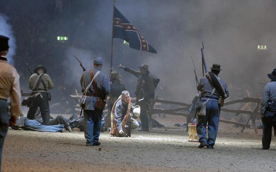 Members of the Southern Skirmish Association Civil War re-enactment group play out the 1864 Battle of Franklin, where the Confederate army advanced upon the Union army at Franklin, Tenn. The performance was part of the British Military Tournament, held Dec. 2-4, 2011 in London.
