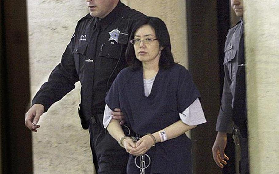 Emiko Inoue, the 43-year-old Japanese woman charged with unlawfully taking her daughter to Japan in 2008, a violation of U.S. custody orders, is escorted into a Milwaukee County court on Nov. 21, 2011. Inoue made a plea deal that will let her be released from jail if her daughter is returned to the States where her father lives.