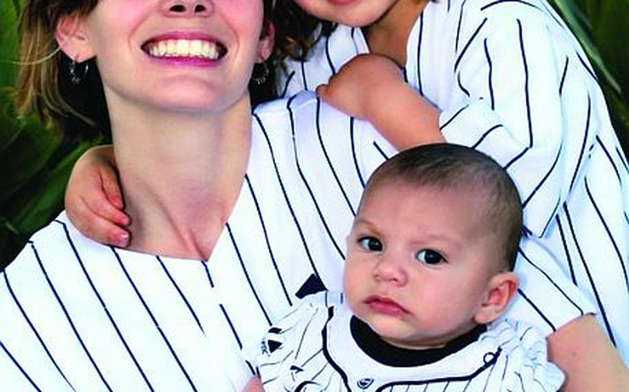 The airman husband of Kelli Abad said Thursday she may have committed suicide after leaving a cryptic note in her abandoned vehicle. Here, Abad poses with her two children for a family photo in 2010.