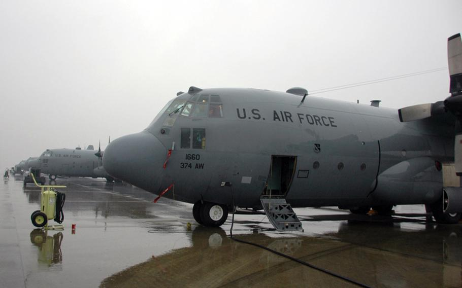 A 36th Airlift Squadron C-130 Hercules waits at Yokota Air Base on Thursday to fly to Guam to participate Operation Christmas Drop.