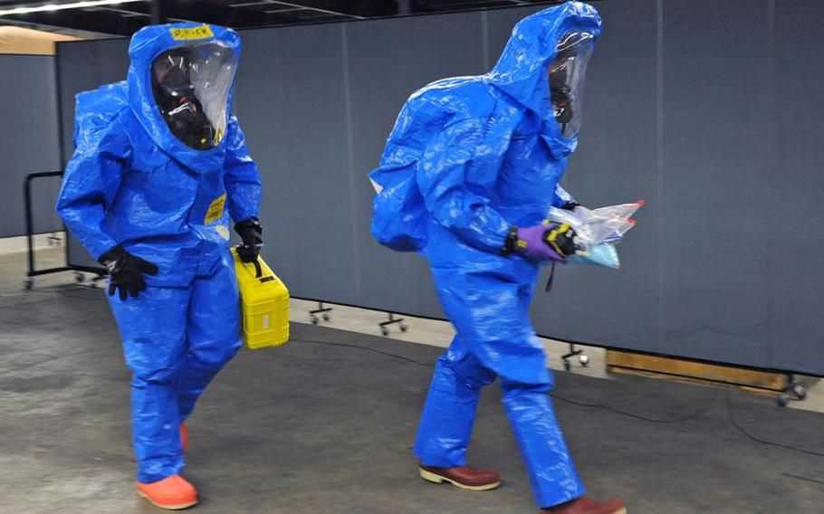 Staff Sgt. Tim Butler, left, and Sgt. David Larkin, both of the 773rd Civil Support Team head into a mock contaminated zone during a training exercise in Kaiserslautern on Dec. 6. The 773rd CST is the only active Army Reserve Civil Support Team stationed outside of the continental U.S., and is capable of deploying in support of U.S. Army Europe in response to a chemical, biological, radiological or nuclear incident.