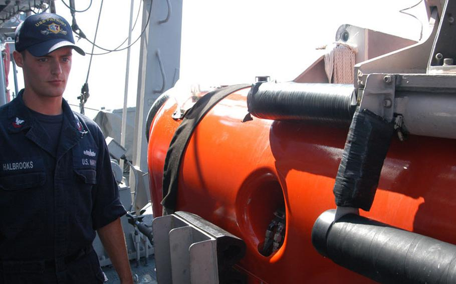 Petty Officer 2nd Class Joshua Halbrooks surveys the mine countermeasure ship USS Patriot's gear on a late October trip to Kagoshima and exercises with the Japanese.