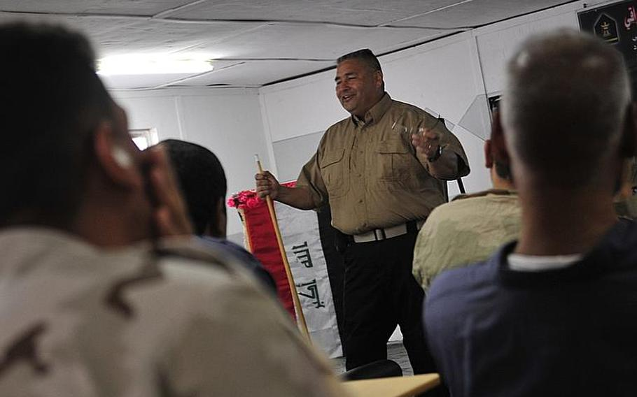 Vic Martinez,vehicle maintenance instructor, covers the basics of vehicle maintenance Oct. 10with Iraqi Army vehicle maintainers in Besmaya, Iraq. The 10-day course focused on engine repair, inspections, and general safety.
