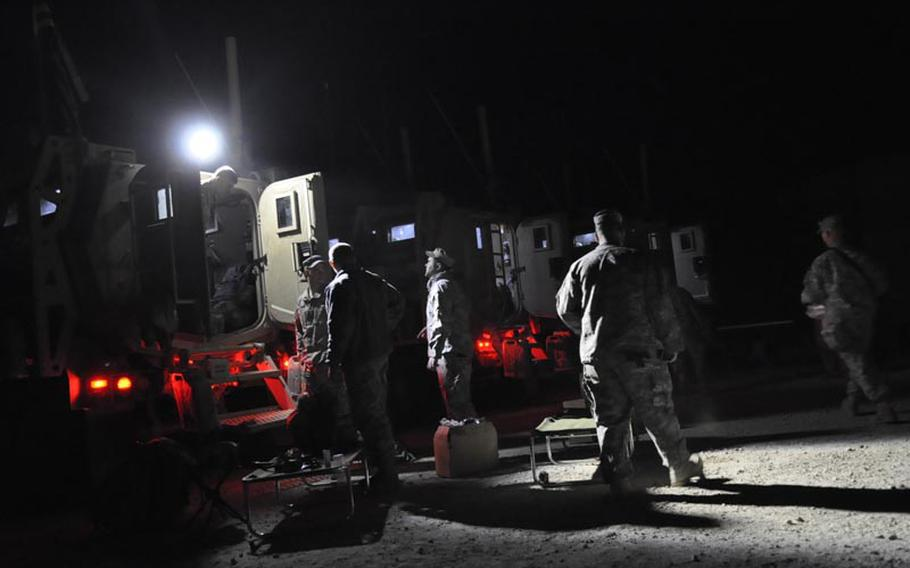 Soldiers with the 1st Combined Arms Battalion, 194th Armor, wait to roll out of Camp Echo, Iraq, on Friday night. It was  one of only two U.S. bases still open in Iraq as of early Saturday.