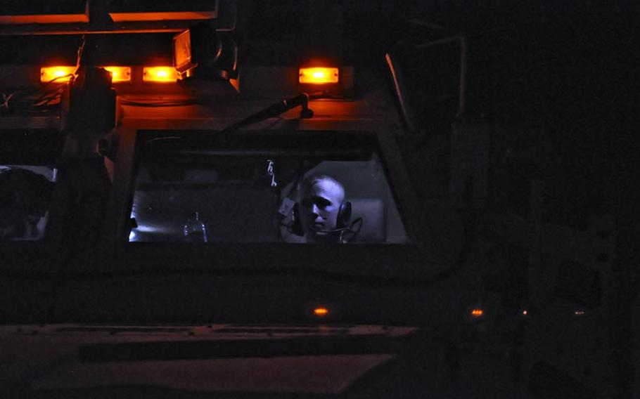 Spc. Michael Mossmann, of the 1st Combined Arms Battalion, 194th Armor, waited in his MRAP before his convoy rolled out of Camp Echo, Iraq, toward the Kuwaiti border, the unit's final mission in Iraq and one of the last of the war.