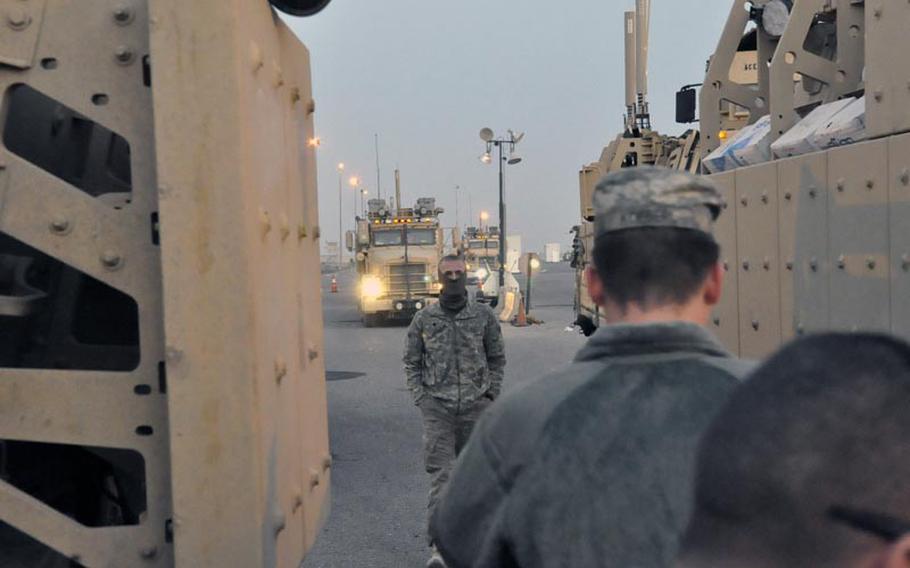 Spc. Michael Mossman at the Iraq-Kuwait border crossing Saturday morning. Mossmann's unit, the 1st Combined Arms Battalion, 194th Armor, completed its final mission into and then out of Iraq Saturday.