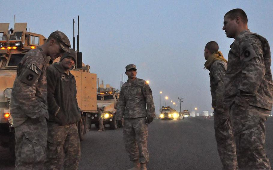 Soldiers with the 1st Combined Arms Battalion, 194th Armor, hang out Saturday morning after crossing the Kuwaiti border from Iraq for the last time. Over the past few months, the unit has provided security escorts for convoys moving materiel out of Iraq as U.S. bases close down ahead of President Barack Obama's Dec. 31 withdrawal deadline.