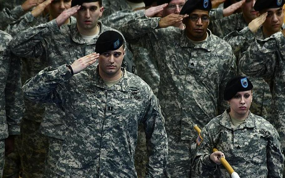 V Corps soldiers salute during the change-of-command ceremony Tuesday at Wiesbaden Army Air Field, Germany.