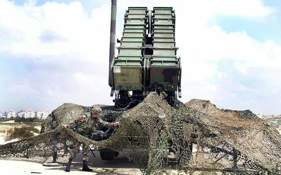A soldier from V Corps' Alpha Battery, 5th Battalion 7th Air Defense Artillery, positions a Patriot missile launcher in Tel Yona, Israel, as part of field training supporting exercise Juniper Cobra in 2005. A similar exercise is to be held in Israel this year and comes at a time of heightened tensions between Israel and Iran.