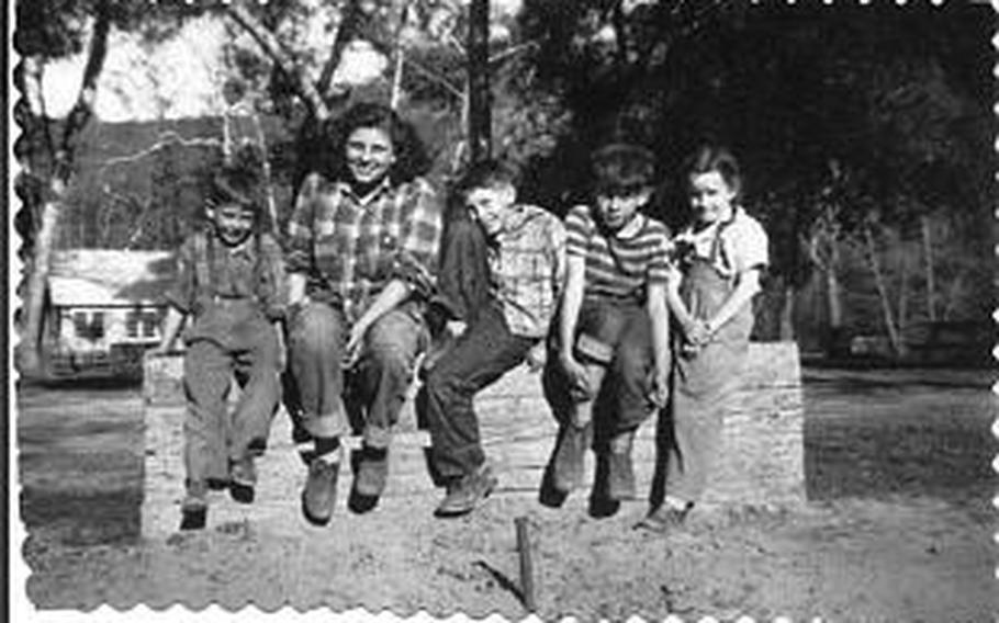 """The Pratt kids, from left to right, Bruce, Eva, Donovan, Terry, and Molly. The photo was taken in Calif. in 1945 at the end of the war. They were unaware that their father, Art Pratt had died two years earlier at the hands of the Japanese at the age of 41, one of the """"Wake 98."""" Photo Courtesy of Pratt Family"""