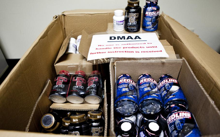 Bottles of dietary supplements containing dimethylamylamine, or DMAA, sit in boxes in the Yokota exchange store room. The Army and Air Force Exchange Service pulled the supplements from the shelves as the Defense Department investigates a possible link between DMAA and the deaths of two soldiers.