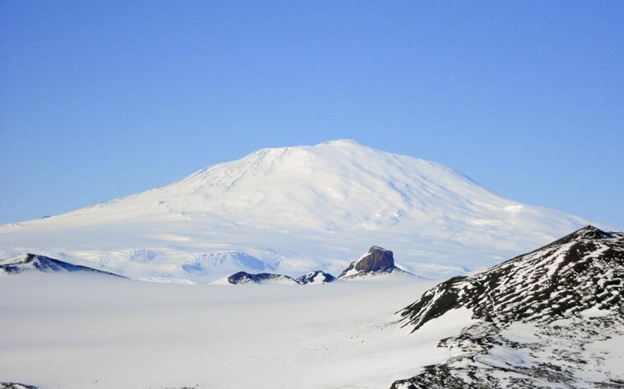 Mount Erebus, an active volcano, looms over McMurdo Station, Antarctica, on a fine day in January.