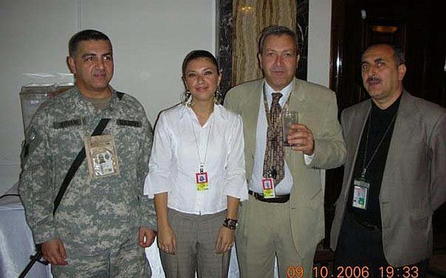 In this photo, taken about a month prior to his abduction at a VIP function in Baghdad, Staff Sgt. Ahmed Altaie, far left, poses for photos with VIPs. Altaie, shown here with the name ''Jeovane'' on his uniform for security purposes, is the last servicemember to be held as a prisoner of war in Iraq. He was abducted on Oct. 23, 2006 after sneaking outside the Green Zone to visit his Iraqi wife.