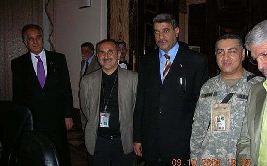 In this photo, taken about a month prior to his abduction at a VIP function in Baghdad, Staff Sgt. Ahmed Altaie, second from right, poses for a photo with VIPs including U.S. ambassador to Iraq Zalmay Khalilzad, far left, who would later go on to serve as U.S. ambassador to the United Nations. Friends and family say that Altaie, shown here with the name ''Jeovane'' on his uniform for security purposes, worked as a translator for Khalilzad. Altaie is the last servicemember to be held as a prisoner of war in Iraq. He was abducted on Oct. 23, 2006 after sneaking outside the Green Zone to visit his Iraqi wife.