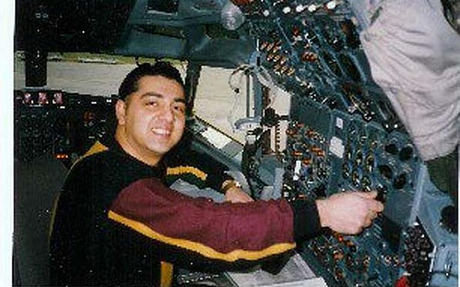 In this undated photo, Staff Sgt. Ahmed Altaie smiles as he sits behin the controls of a plane. The amateur pilot had a passion for flying and was an airplane mechanic prior to the Sept. 11 attacks, family and friends said.