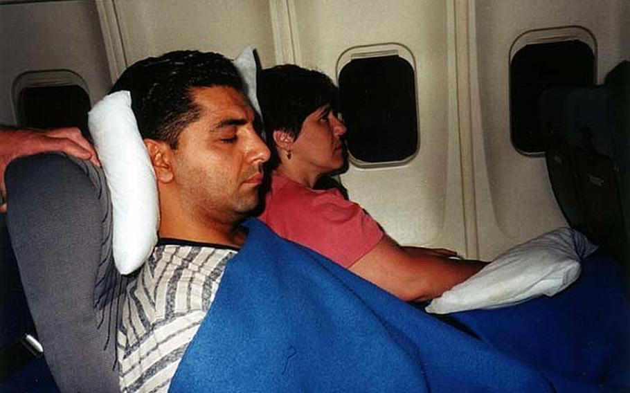 In this undated photo, Staff Sgt. Ahmed Altaie sleeps on a plane while traveling. Altaie is the last servicemember to be held as a prisoner of war in Iraq. He was abducted on Oct. 23, 2006 after sneaking outside the Green Zone to visit his Iraqi wife.