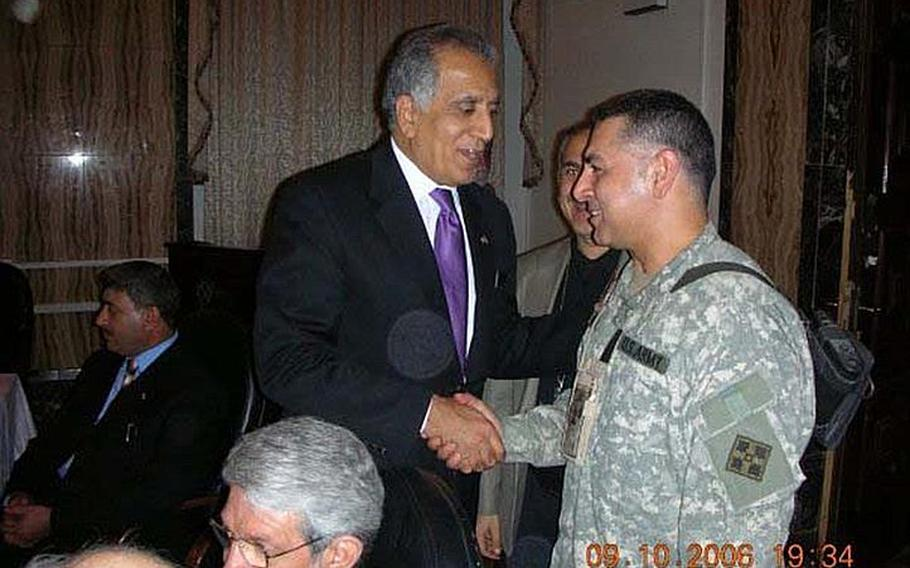 """In this photo, taken about a month prior to his abduction at a VIP function in Baghdad, Staff Sgt. Ahmed Altaie, right, shakes hands with U.S. ambassador to Iraq Zalmay Khalilzad, who would later go on to serve as U.S. ambassador to the United Nations. Friends and family say that Altaie, shown here with the name """"Jeovane"""" on his uniform for security purposes, worked as a translator for Khalilzad. Altaie is the last servicemember to be held as a prisoner of war in Iraq. He was abducted on Oct. 23, 2006 after sneaking outside the Green Zone to visit his Iraqi wife."""
