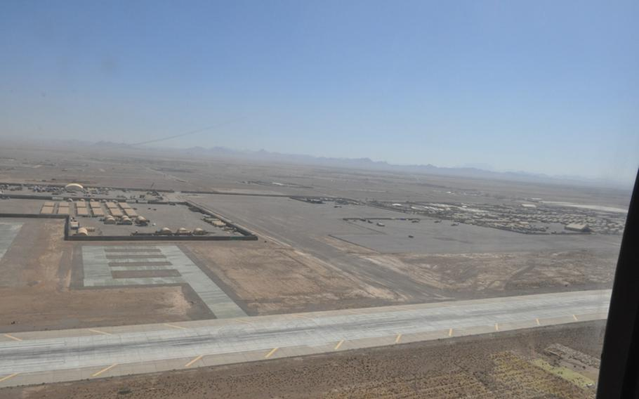 Shindand Air Base, a portion of which is seen from the open door of a Black Hawk in flight, is the second-largest coalition forces airfield in Afghanistan and home to the nation's fledgling Air Force Academy.