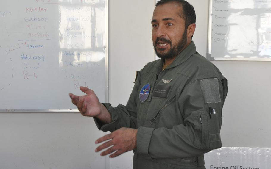 First Lt. Abdul Saboor, a pilot with the Afghan Air Force, leads a debriefing at Shindand Air Base after a training flight. ''We want to defend Afghanistan,'' he later said, ''and if the people see us taking control of our security, we will feel more together as a country.''