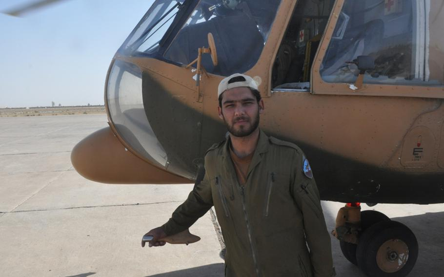 Afghan Air Force recruit Mohammad Haroon, shown before a training flight at Shindand Air Base in Herat province, said the country's military isn't ready to be self-reliant. ''We need the U.S. to stay to help us.''