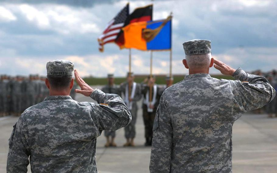 Col. Van J. Voorhees, commander of the 12th Combat Aviation Brigade, and Lt. Gen. Mark Hertling, commader of U.S. Army Europe, salute during a colors casing ceremony for the brigade on April 20, 2012, in Katterbach, Germany. The brigade's units are deploying to Afghanistan and Kuwait for a 10-month tour.