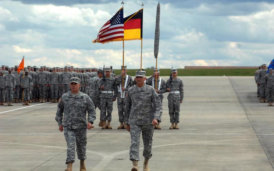 Col. Van J. Voorhees, left, commander of the 12th Combat Aviation Brigade, and Lt. Gen. Mark Hertling, commader of U.S. Army Europe return to the reviewing stand as part of a colors casing ceremony for the brigade on April 20, 2012, in Katterbach, Germany. The brigade's units are deploying to Afghanistan and Kuwait for a 10-month tour.