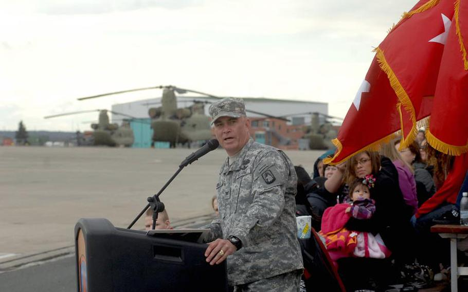 Col. Van J. Voorhees, commander of the 12th Combat Aviation Brigade, speaks to attendees at a colors casing ceremony for the brigade on April 20, 2012, in Katterbach, Germany. The brigade's units are deploying to Afghanistan and Kuwait for a 10 month tour.