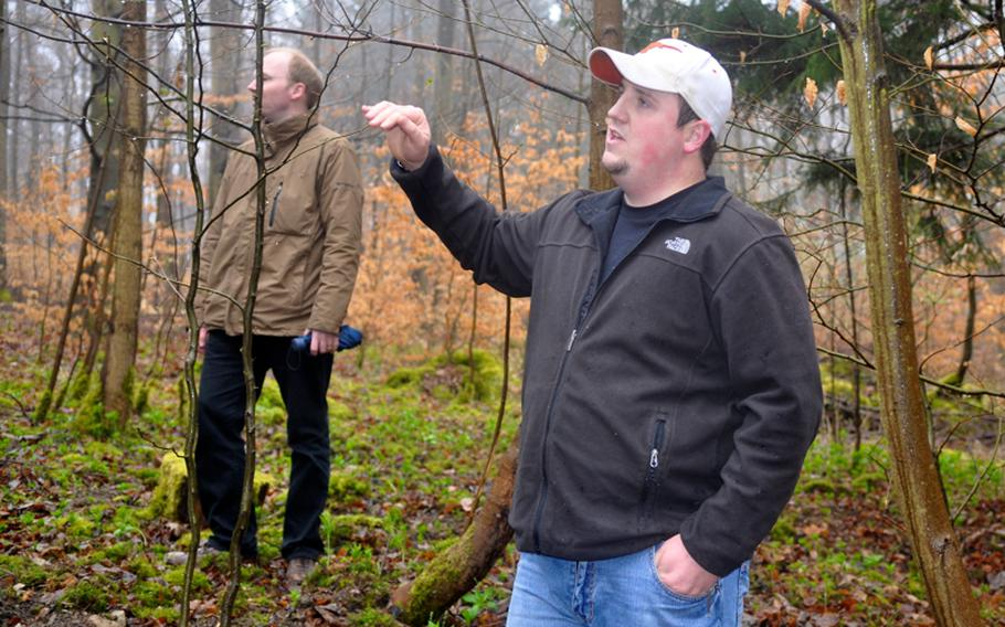 Metal detector enthusiast Kolby Lanham shows Boeblingen Police detectives what he believes is a World War II crash site, April 5, 2012, near the town of Grafenau, Germany. He and his fellow enthusiasts found human remains  they suspect belong to a crewmember of a crashed American bomber.