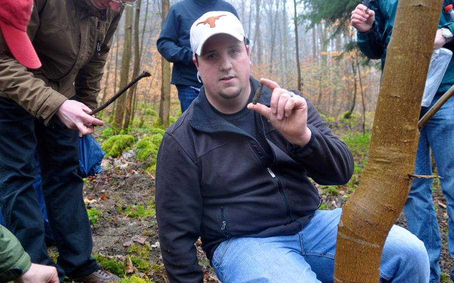 Kolby Lanham, a Spangdahlem-based airman, holds up a .50-caliber bullet found at what is believed to be a World War II crash site near the town of Grafenau, Germany on April 5, 2012.