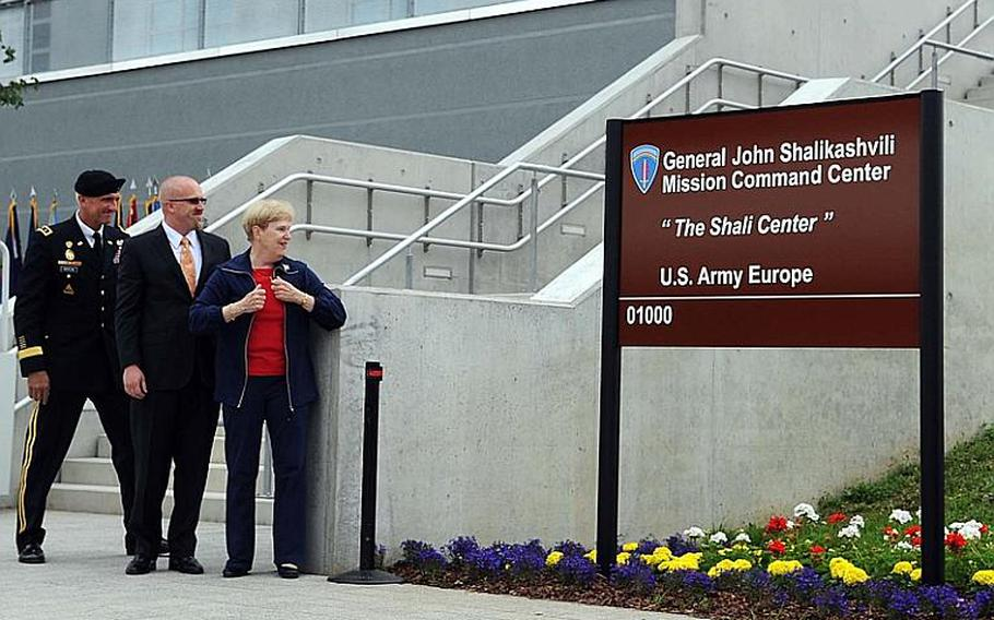 Joan Shalikashvili, her son Brant and U.S. Army Europe commander Lt. Gen. Mark Hertling, from right, look at the the sign they just unveiled, dedicating the new USAREUR mission command center to the former chairman of the Joint Chiefs of Staff, the late Gen. John Shalikashvili, in Wiesbaden, Germany, Thursday.