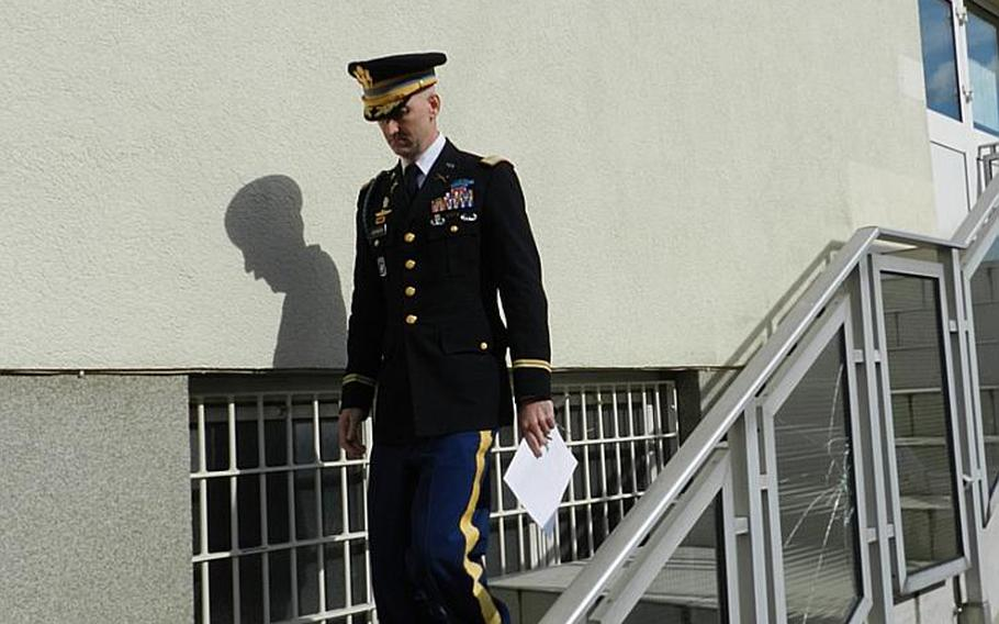 Col. James H. Johnson III leaves the Kaiserslautern, Germany, courtroom after his sentencing in June, 2012.