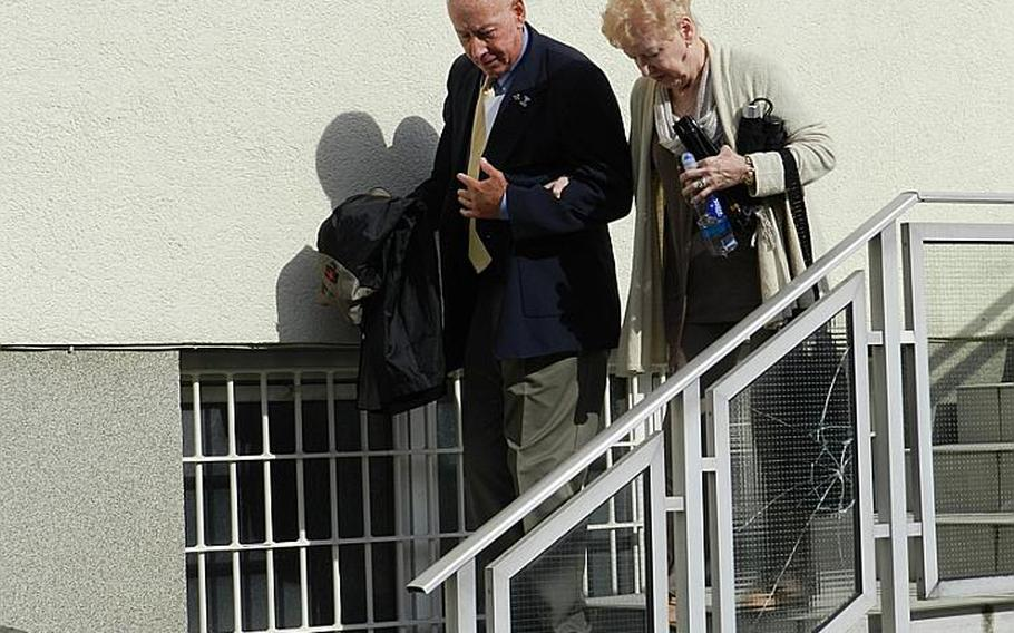 Retired Lt. Gen. James H. Johnson Jr. and his wife, Edna, leave the building in Kaiserslautern, Germany, after the sentencing of their son, Col. James H. Johnson III.