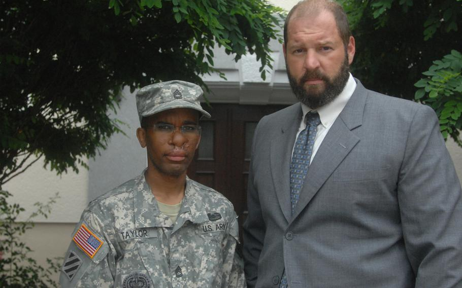 Sgt. 1st Class Walter Taylor stands with his attorney, James Culp, outside the law center in Bamberg, Germany.