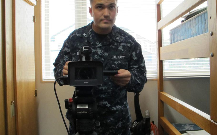 """Petty Officer 3rd Class Scott Bourque is well-known at Sasebo Naval Base, Japan, for his LMFAO-spoofing song """"Hungry and I Know It,"""" an AFN ad promoting the food court that required several embarrassing takes."""